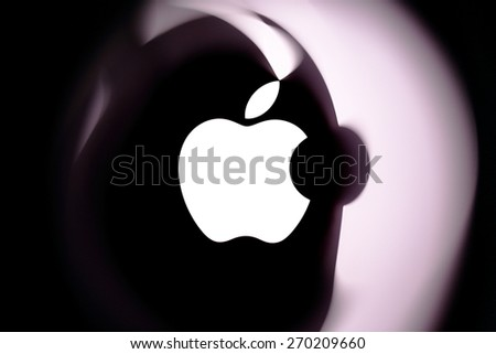 KAMBERK, CZECH REPUBLIC - MARCH 16, 2015:Detail of Apple logo on Mac Book Air reflecting in transparent foil. - stock photo