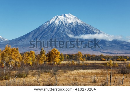 Kamchatka Peninsula landscape: beautiful autumn view of the active Koryak Volcano and blue sky on clear sunny day. Eurasia, Russian Far East, Kamchatka Region, Avachinsky-Koryaksky Group of Volcanoes.