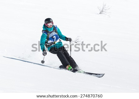 "KAMCHATKA, RUSSIA - MARCH 9, 2014: Girl skier rides steep mountains. Competitions freeride snowboarders and skiers ""Kamchatka Freeride Open Cup"". Russia, Far East, Kamchatka Peninsula."