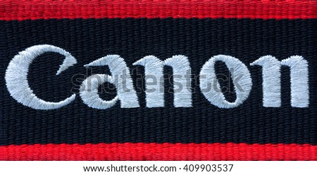 Kamennomostskiy, Russia - 23 April 2016: the Canon Logo on the shoulder strap for the camera