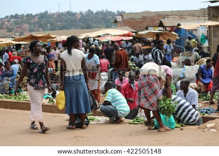 KAMPALA, UGANDA - CIRCA NOVEMBER 2015: Ugandan women gathering at the morning market to sell and buy fresh produce. - stock photo