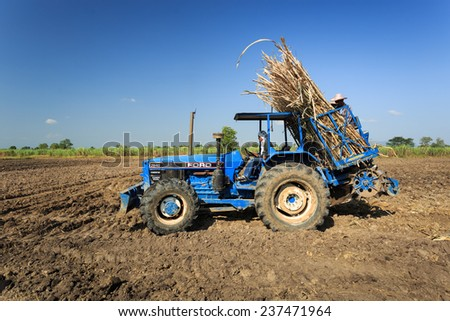 Kamphaengphet, Thailand - 14 December 2014:Farmer was drove tractor for sugarcane planting