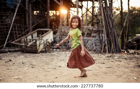 KAMPONG PHLUK,CAMBODIA - JANUARY 01: Portrait of an unidentified Khmer girl on Tonle Sap Lake in Kampong Phluk,Cambodia on 01.2014 January .It is the largest lake in Southeast Asia  - stock photo