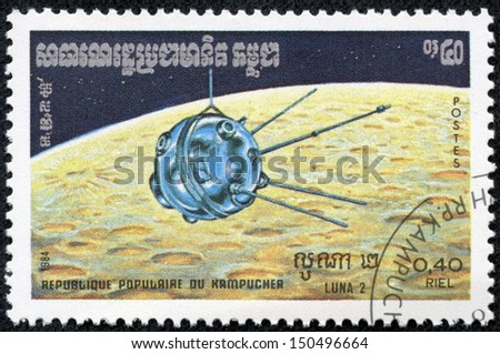 KAMPUCHEA - CIRCA 1984: a stamp from Kampuchea shows image of Soviet space probe Luna 2, circa 1984 - stock photo