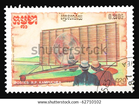 KAMPUCHEA - CIRCA 1987: A stamp printed in Kampuchea showing multiple flying machine, circa 1987 - stock photo