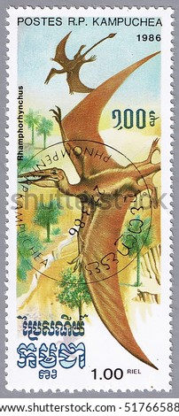 KAMPUCHEA - CIRCA 1986: A stamp printed in Kampuchea shows Rhamphorhynchus, series devoted to prehistoric animals, circa 1986 - stock photo