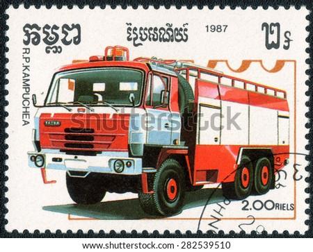 "KAMPUCHEA - CIRCA 1987: A stamp printed in Kampucheashows a shows a series of images ""Fire trucks"", circa 1987 - stock photo"