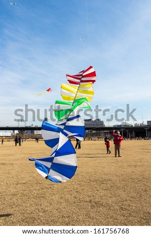 Kanagawa, Japan - January 13: Unidentified man flies Kite in the New Year's Kite Festival at Nissan Stadium on January 13, 2013 in Kanagawa, Japan.