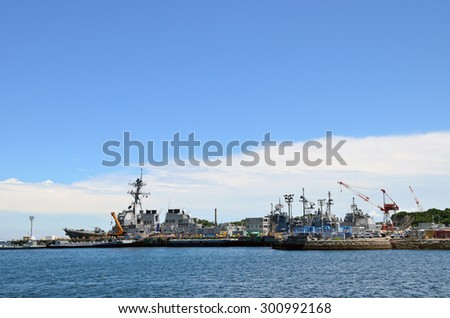 Kanagawa, JAPAN - July 15, 2015; A photo of an US Navy Ships in Yokosuka port. Yokosuka Port is naval port. Many of the Japan Maritime Self-Defense Force and the US Navy of ships is at anchor.