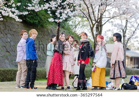 KANAZAWA,JAPAN - 8 April,2014 : Young Japanese people looking at camera on their relax time at Cherry blossom garden around Kenrokuen garden and Kanazawa castle.