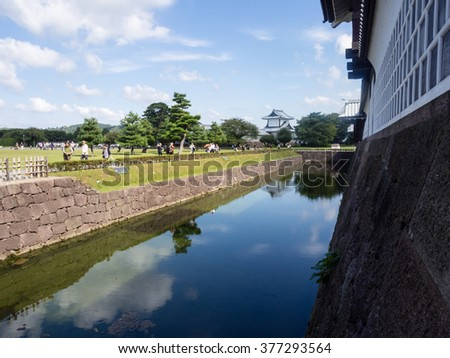 Kanazawa, Japan - September 28, 2015: Tourists walking along the moat of historic Kanazawa castle
