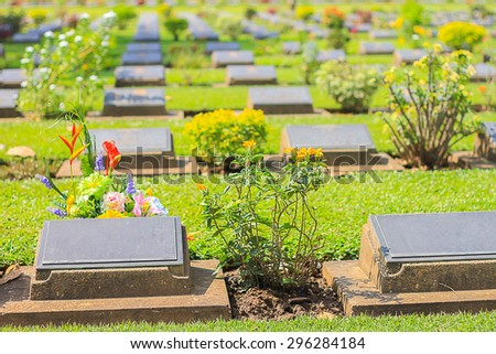 Kanchanaburi cemetery in Thailand ; selective focus with blur background. - stock photo