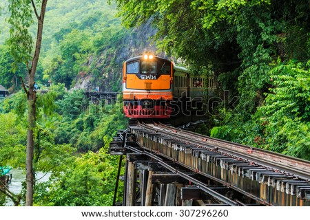 KANCHANABURI PROVINCE, THAILAND - June 18: Train rides on Burma railway in Kanchanaburi province, Thailand on June 18, 2015. Railway was built by Japan in 1943, to support its forces in World War II. - stock photo