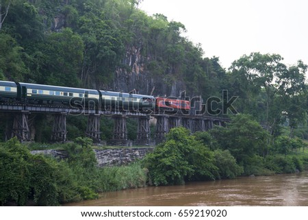 Kanchanaburi,Thailand-APRIL 29,2014:The luxury train Orient-Express running through the Death Railway in Kanchanaburi,Thailand.Thailand-Burma Railway built by the Empire of Japan on World War II.
