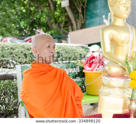KANCHANABURI,THAILAND - AUGUST 12: Buddhist monk on August 12,2015 in Kanchanaburi Province in Thailand. Buddhism is the most popular religion in Thailand - stock photo