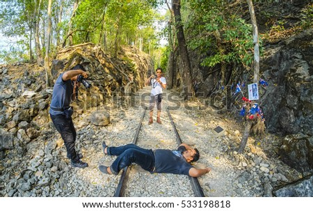 KANCHANABURI, THAILAND - DECEMBER 16, 2015 : Tourists taking picture of railway during visit at Hellfire pass. This Burma-Thailand railway construction during World War 2.