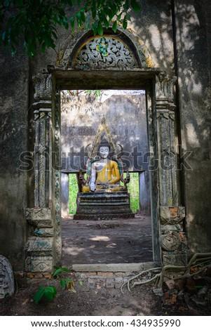 KANCHANABURI, THAILAND - 17 May 2014: Buddha statue in Buddhist Temple abandoned location Sagklaburi at KANCHANABURI - stock photo