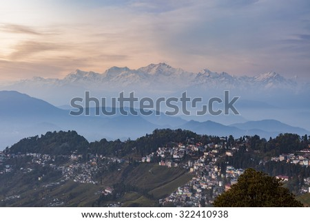 Kanchenjunga range peak after sunset with Darjeeling town in the foreground , Sikkim, India. - stock photo