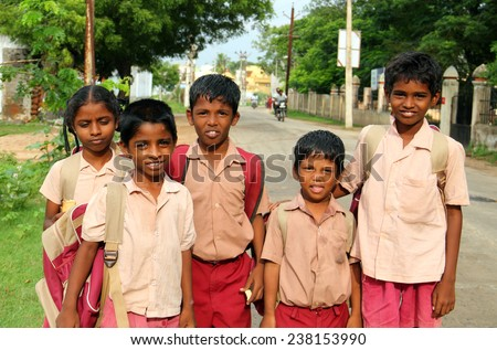 KANCHI, INDIA - AUG 16: Unidentified hindu school children dressed in uniform go home after classes on August 16, 2013 in Kanchipuram, Tamil Nadu, Southern India - stock photo