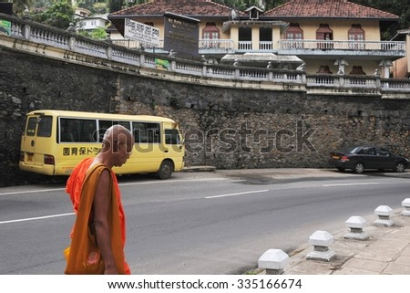 KANDY, SRI LANKA - DECEMBER 5, 2008: Monk on the street of Kandy city. Kandy is a city in the Central part of Sri Lanka. Known as one of the sacred Buddhist cities.