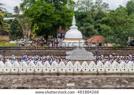 KANDY, SRI LANKA - JULY 19, 2016: White clothed Buddhist devotees at the Temple of Sacred Tooth Relic during Poya (Full Moon) holiday.