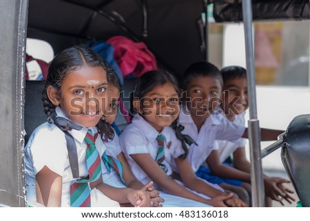 KANDY, SRI LANKA - MARCH 17, 2016: Children smiling on the car before go to school and looking at camera on March 17, 2016 in Kandy, Sri Lanka.