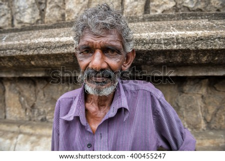 KANDY, SRI LANKA - MARCH 16 : Portrait of close up of long beard and mustache man stand at market on March 16, 2016 in Kandy, Sri lanka.