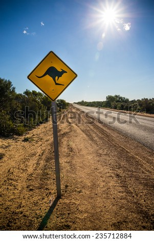Kangaroo warning signal in a hot summer day, australian outback - stock photo