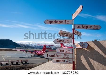 Kangerlussuaq, Greenland - May 16,2011: A direction sign to various world cities at Kangerlussuaq international airport, Greenland.Kangerlussuaq Airport is the international hub for Air Greenland. - stock photo
