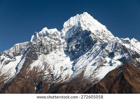 Kangtega and Thamserku - beautiful mounts above the Namche Bazar on the way to Everest Base Camp - Nepal  - stock photo