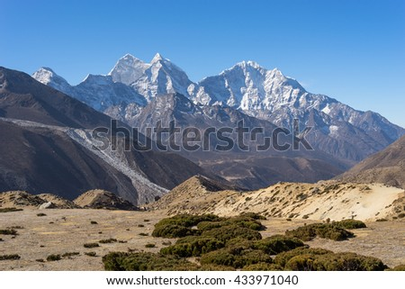 Kangtega and Thamserku mountain landscape, Everest region, Nepal - stock photo