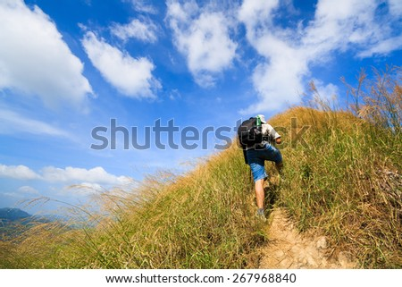 Kanjanaburi,Thailand - November 26, 2010: traveler walk along on a trail on the ridge of mountain at the Thongphaphum national park in Thailand. - stock photo
