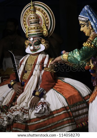 KANNUR - DECEMBER 06: Unidentified Kathakali performers enact stories from the Hindu epics in full costume and make-up on December 06, 2011 in a small village near Kannur, Kerala, India.