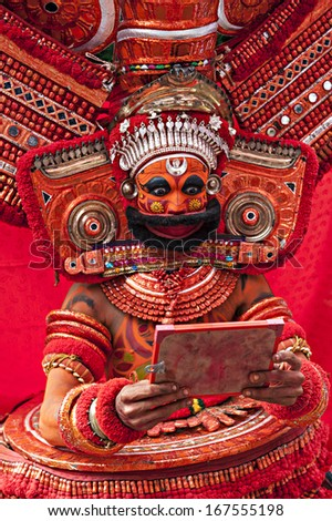 KANNUR, INDIA - NOVEMBER 28: an unidentified Theyyam performer in full costume during a performance of Hindu religious dance and drama on November 28, 2011 near a village in Kannur, Kerala, India.