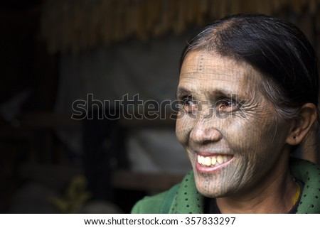 KANPETLET MYANMAR, DECEMBER 9: Chin tribe tattoed woman (Yin Duu) poses for a photo on December 9, 2015 Kanpetlet, Myanmar. Also known as the Kakis they are a number of Tibeto-Burman tribal people.