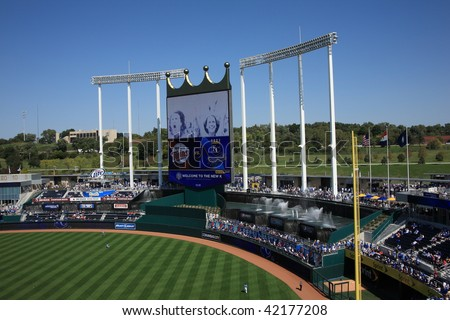 KANSAS CITY - SEPTEMBER 27: Royals fans watch in a baseball game near the signature crown scoreboard and fountains of Kauffman Stadium on September 27, 2009 in Kansas City, Missouri.