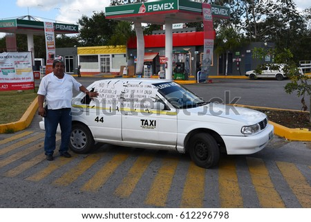 KANTUNILKIN, MEXICO -JANUARY 20 2017:Taxi drivers  blocking the entrance to gas station in Kantunilkin Mexico at January 20, 2017.Transporters and taxi drivers were protesting the rise of gas.