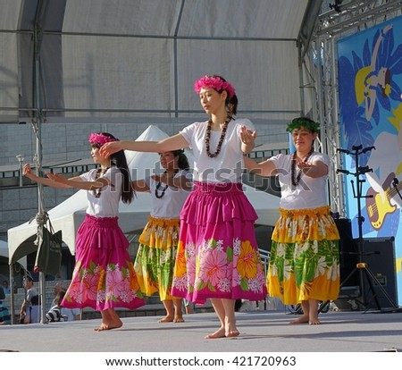 KAOHSIUNG, TAIWAN -- APRIL 23, 2016: A group of unidentified dancers performs a Hawaiian dance at the 1st Pacific Rim Ukulele Festival, a free public outdoor event.