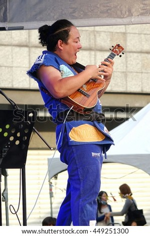 KAOHSIUNG, TAIWAN -- APRIL 23, 2016: Award-winning Japanese musician Yuta Uchiumi performs at the 1st Pacific Rim Ukulele Festival, a free outdoor event.