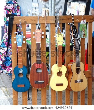 KAOHSIUNG, TAIWAN -- APRIL 23, 2016: Outdoor vendors sell musical string instruments at the 1st Pacific Rim Ukulele Festival, a free outdoor event.