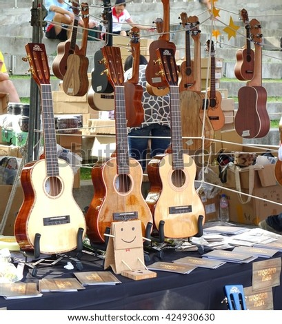 KAOHSIUNG, TAIWAN -- APRIL 23, 2016: Outdoor vendors sell musical string instruments at the 1st Pacific Rim Ukulele Festival, a free public outdoor event.