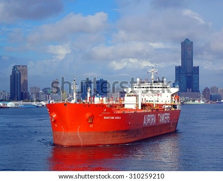 KAOHSIUNG, TAIWAN -- AUGUST 12, 2015: The Hong Kong registered oil tanker Maritime Gisela makes its way towards the Kaohsiung Port exit.   - stock photo