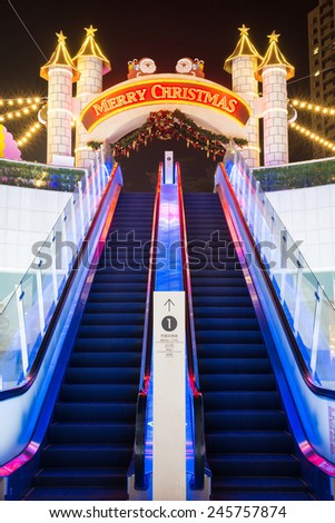 Kaohsiung, Taiwan, Dec,24,2014: The HanshinArena Department Store Celebrates The Christmas. The Entrance of The Escalator Is Decorated with A Gate in Castle Style And Joyful Lights. - stock photo