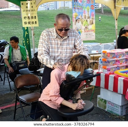 KAOHSIUNG, TAIWAN -- FEBRUARY 13, 2016: Vision impaired people offer massage services  during the 2016 Lantern Festival.