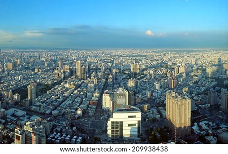 KAOHSIUNG, TAIWAN -- JULY 13, 2014:  A birds eye view of Kaohsiung City in Taiwan from west to east - stock photo