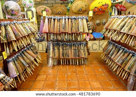 KAOHSIUNG, TAIWAN -- JULY 24, 2016: A shop sells hand-painted oil-paper umbrellas, which are traditional art and craft products by the Chinese Hakka people.