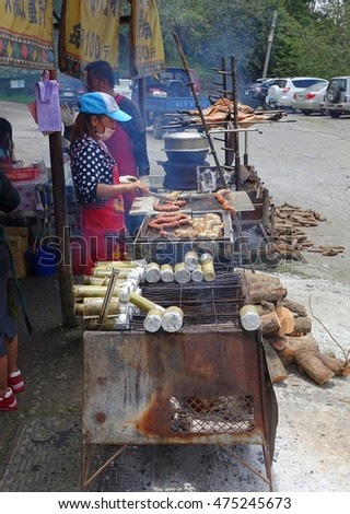 KAOHSIUNG, TAIWAN -- JULY 24, 2016: A traditional market in the aboriginal mountain village of Baoshan offers roast pig, sausages, rice cooked in bamboo and other foods.