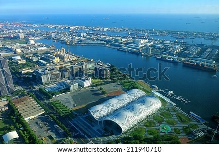 KAOHSIUNG, TAIWAN -- JULY 13, 2014:  An aerial view of Kaohsiung Port with the new Exhibition Center in the foreground. - stock photo
