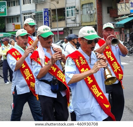 KAOHSIUNG, TAIWAN -- JULY 9, 2016: Participants in a Daoist religious ceremony play the Suona, a traditional Chinese wind instrument.