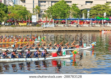 Kaohsiung, Taiwan, June 20, 2015: Boats racing in the Love River for the Dragon Boat Festival in Kaohsiung, Taiwan.  - stock photo